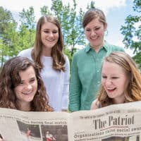 Editors of the Patriot reading the newspaper