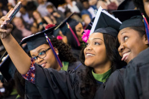 FMU graduates taking a photo at commencement