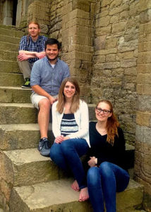 Honors students sitting on steps in Spain