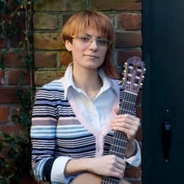 Dr Alma Van Duys with guitar