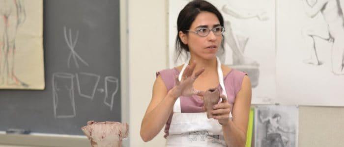 Professor demonstrates sculpting in workshop