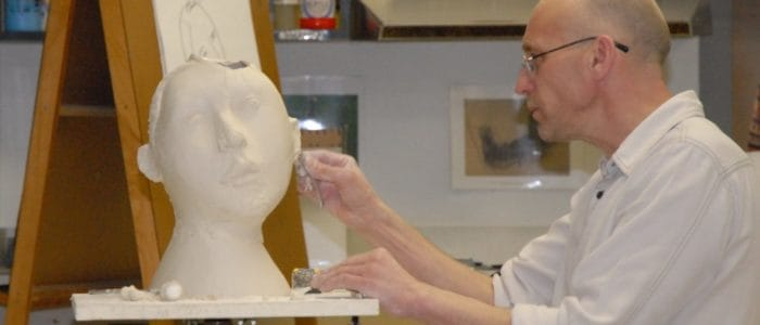 Man Sculpting in Fine Arts