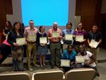 Nine people holding their certificates from the FMU Math Conference