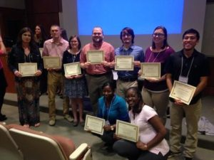 Nine students holding their certificates at the FMU Math Conference