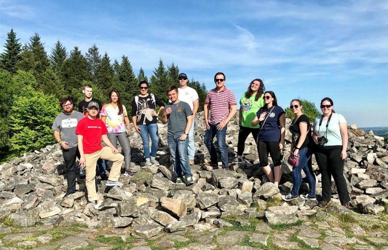 Political Science students standing on rocks in Germany