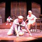 Student on the floor during FMU's production of All Timing