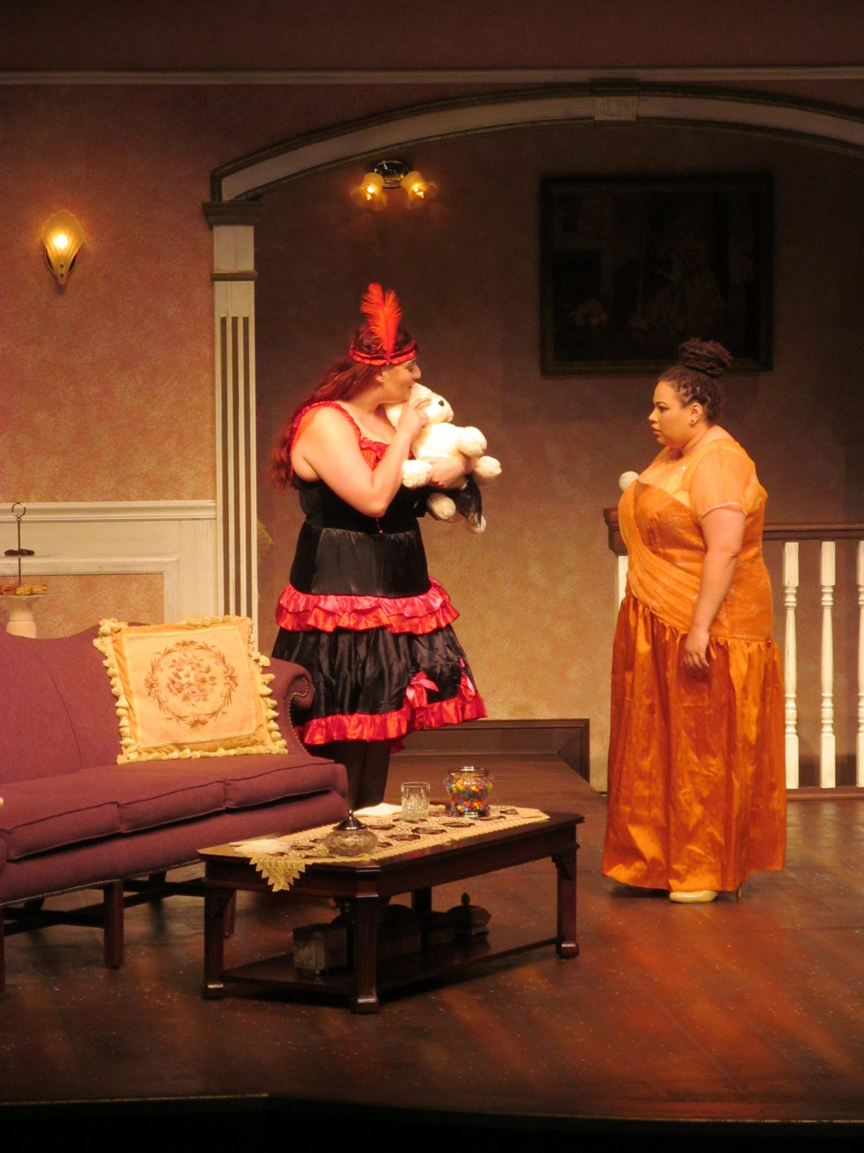 Two women on stage performing in the FMU Theatre