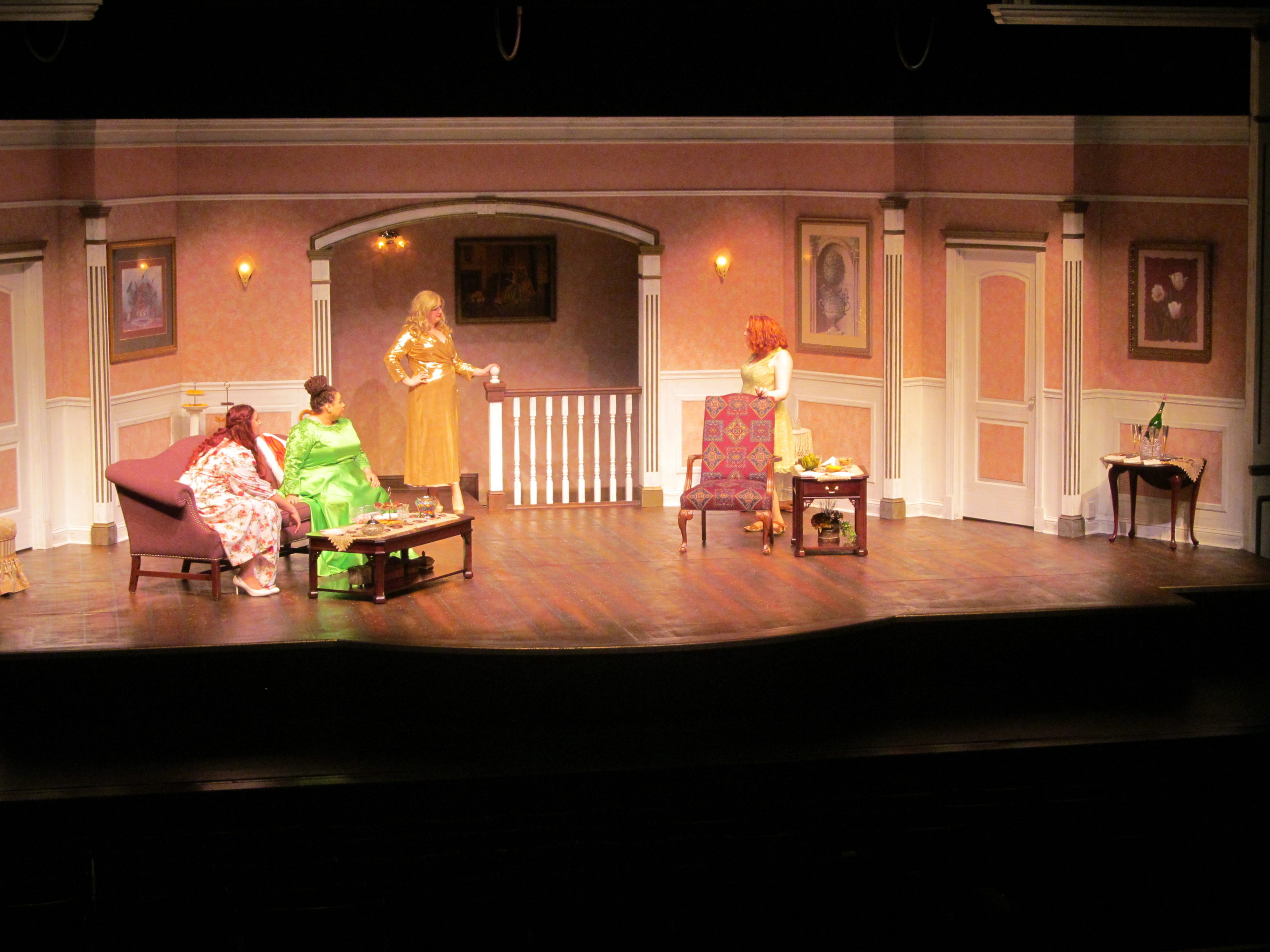 Four women on stage performing Bridesmaids