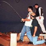 Man fishing on set of Catfish Moon