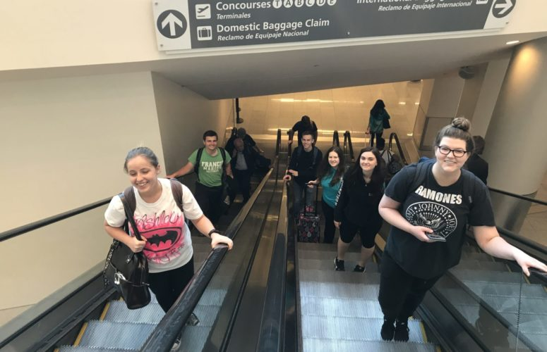 Students on the escalator in the ATL Airport