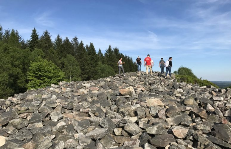 Students on top of rocks during a hike