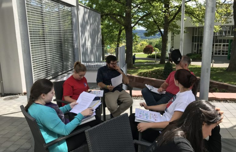 Students sitting outside doing work