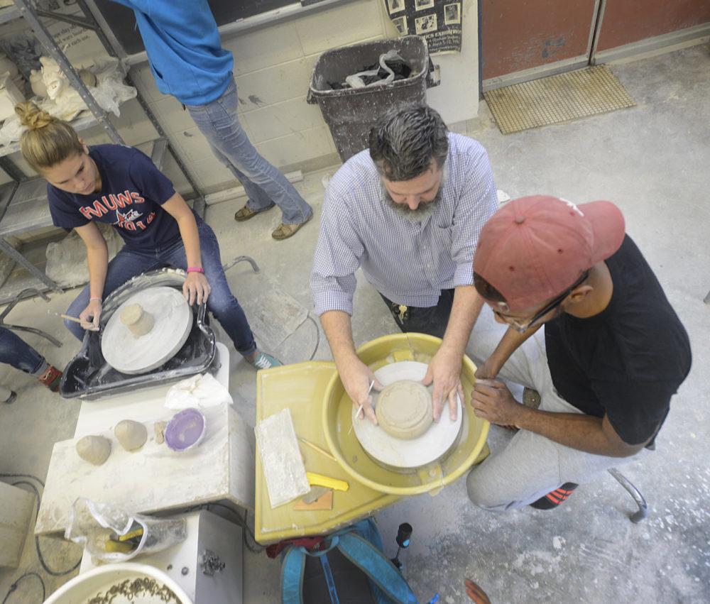 FMU students and professors sculpting in class