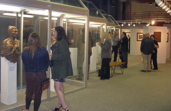 People observing Recent Sculptural Works by Alex Palkovich