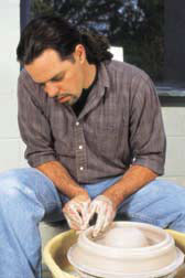 Doug Gray sculpting a pot