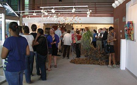 Vistors observing artwork at FMU visual arts show