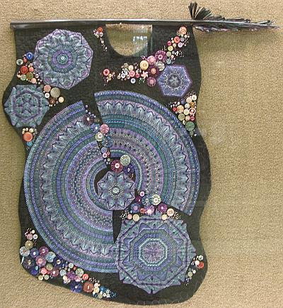 Black kaleidoscope with blue and purple and various details