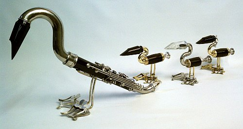 """""""Duck Family"""" by Jim Gleason, with objects made to look like a mother duck and her ducklings"""