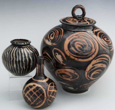 Brown pots with swirled details on the side