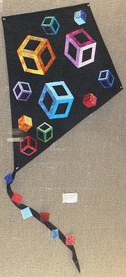 Swamp Fox Quilters Guild in black with colorful cubes