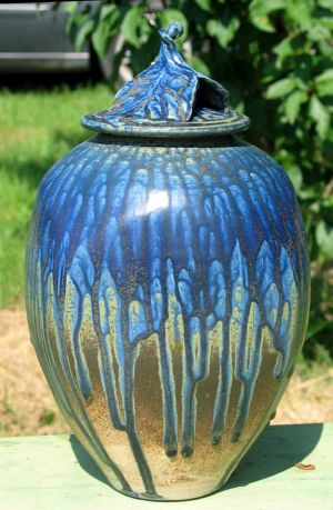 Blue and Green vase sitting outside