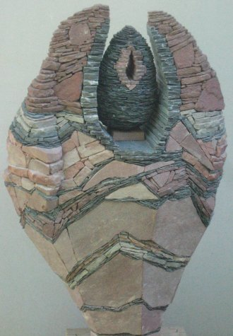 """Joy"" by Tom Herzog, a stack of rocks made to build a mural"
