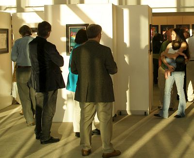 People admiring artwork at Visual Arts Senior show
