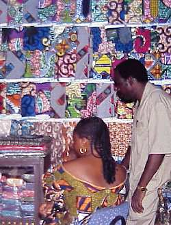 Two people standing in front of West African Printed Textiles