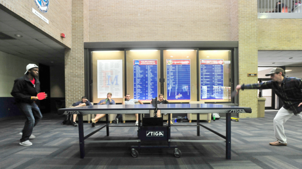Two students playing ping pong in the University Center