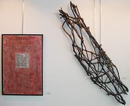 Red and wooden artwork hanging on the wall