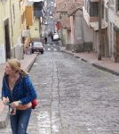 Cropped photo of woman walking up a street
