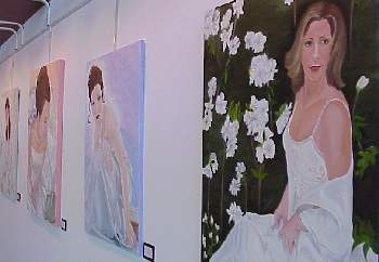 Three paintings on a all at FMU Senior Art show