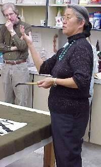 Professor teaching calligraphy