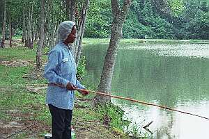 Danger in the Idyllic: South Carolinians at Risk- woman fishing in lake