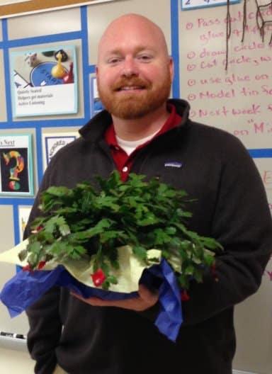 Sean Lafaye holding a plant
