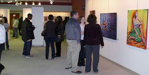People talking amongst themselves at senior Show Gallery Reception
