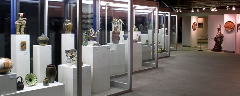 Art pieces inside glass boxes lined up