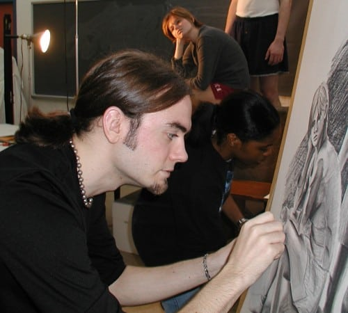 Busscher drawing on a canvas