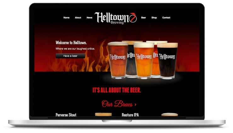 """It's all about the beer"" stated on the Belltown Logo"
