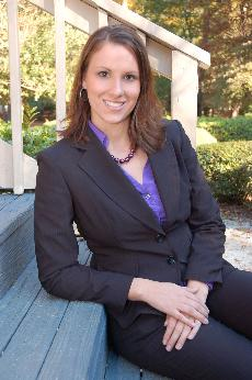 Christal Edwards sitting on steps in a black suit