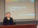 Photo of woman standing infront of Sovereign Logic Powerpoint