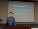 Photo of man standing infront of 30 minutes life powerpoint