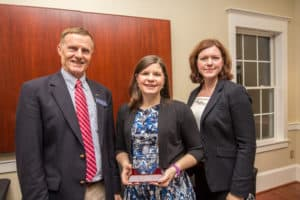 Elizabeth Howell poses for a photo with faculty members.