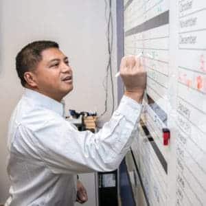 Eddie Vergara drawing on a board
