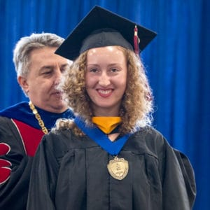 Graduate accepting her honors medallion