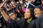 FMU graduates take a selfie at commencement