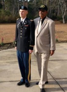 Photo of two men standing together