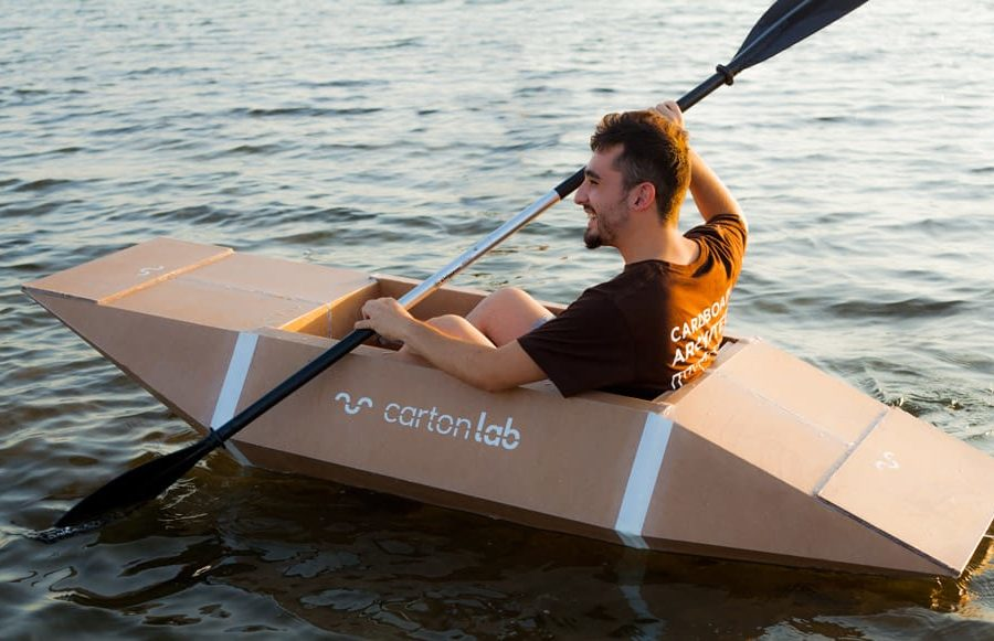 Guy participates in the cardboard boat race
