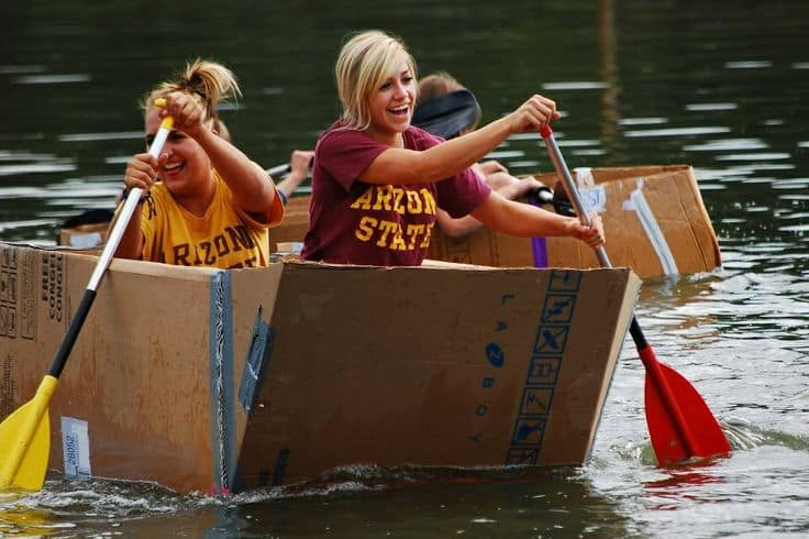 Women rowing their boat in the cardboard boat race