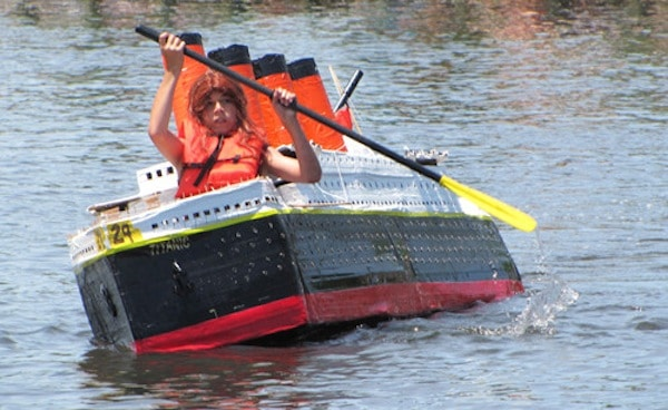 Student rows his boat in the cardboard boat race